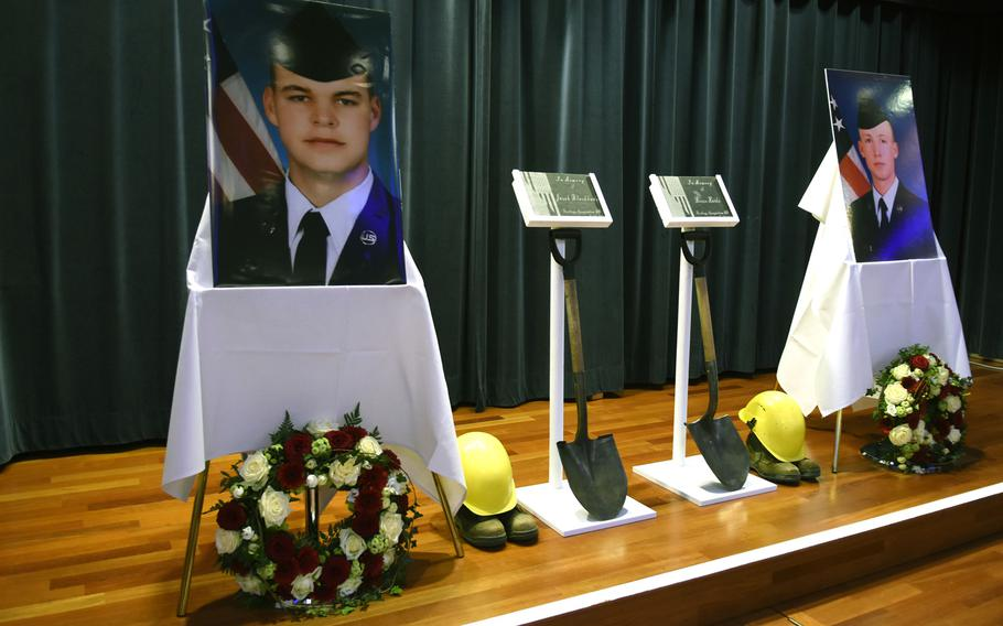 The stage inside the Club Eifel ballroom at Spangdahlem Air Base, Germany, was set up in tribute to Airman 1st Class Jacob A. Blackburn, photograph on left, and Airman 1st Class Bradley Reese Haile, Oct. 22, 2019. The hard hats and shovels represent the ''Dirt Boyz,'' a nickname given to airmen working in heavy equipment and pavement shops.