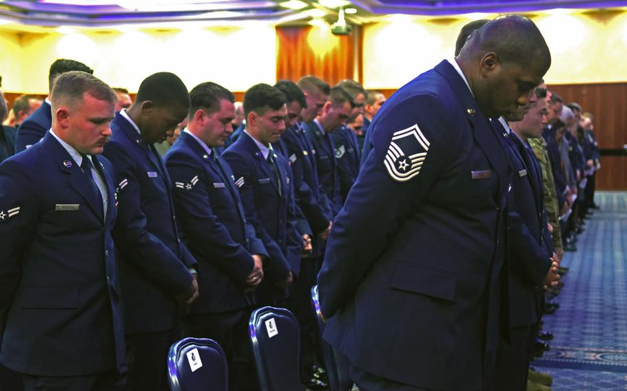 Airmen bow their heads in prayer during a memorial service for Airmen 1st Class Jacob A. Blackburn and Bradley Reese Haile on Tuesday, Oct. 22, 2019, at Spangdahlem Air Base, Germany. Blackburn and Haile were killed in a car crash on base last month.