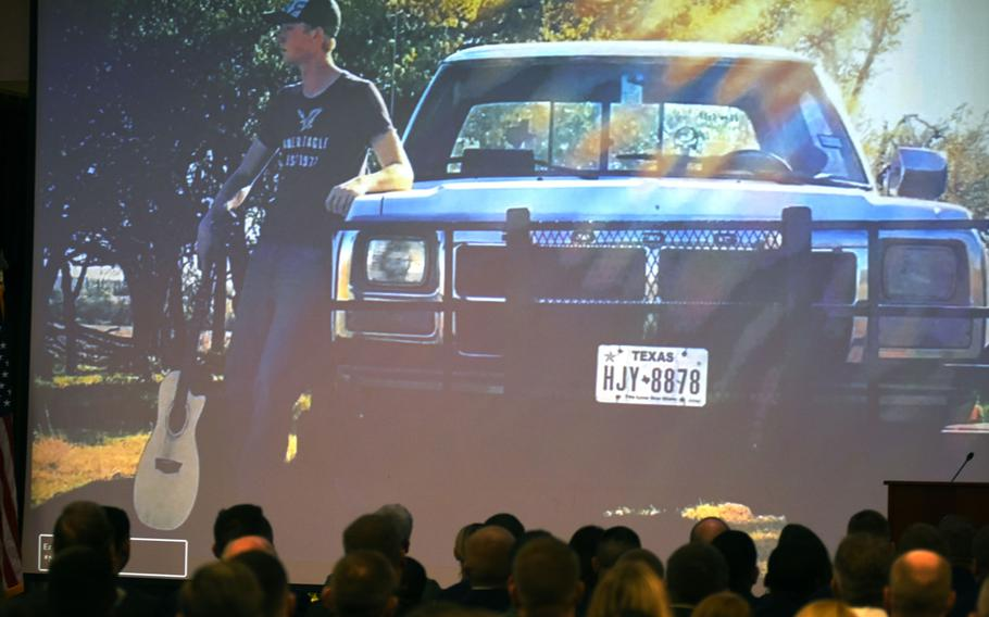 This photograph of Airman 1st Class Bradley Reese Haile, holding a guitar and standing next to his truck, was shown as part of a slideshow during a memorial service for Haile and Airman 1st Class Jacob A. Blackburn on Tuesday, Oct. 22, 2019, at Spangdahlem Air Base, Germany. The two airmen died in a car crash on base on Sept. 30.