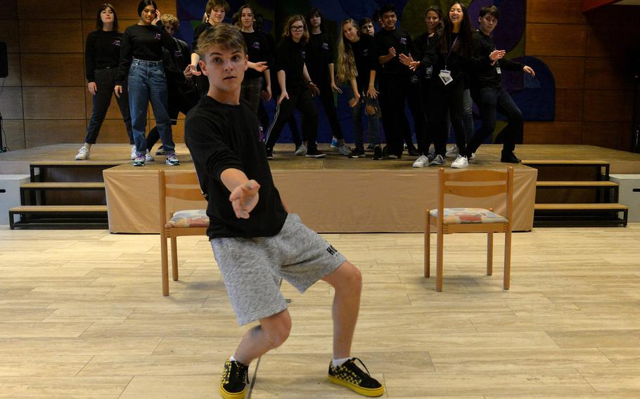 Stuttgart's Caden Burkman shows the Creative Connections show choir his choreography for a number they are working on for Thursday's show.