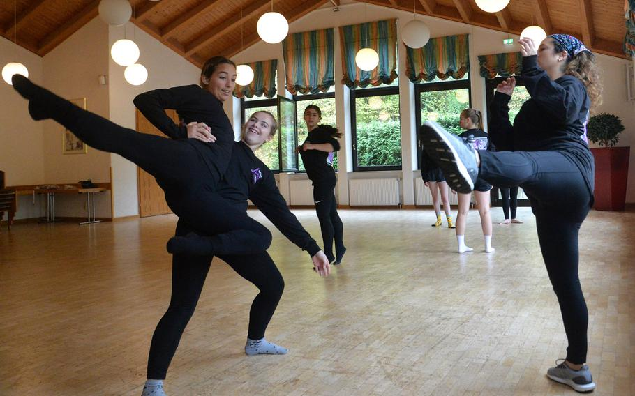 Maya Cabrera from Naples supports Vilseck's Alexana Voudouris as they go through a dance move with instructor Ruth Wareham from Alconbury, during the dance workshop at Creative Connections in Oberwesel, Germany, Monday, Nov. 4, 2019.