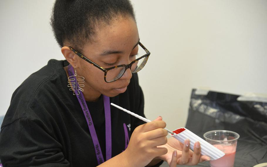 In the mixed media workshop at Creative Connections, Alconbury's Terrica Davis paints a manicotti noodle for the project she was working on, Monday, Nov. 4, 2019.