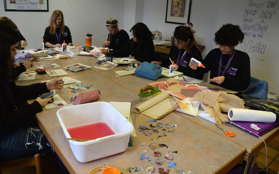 Students in the collect, converge, create, collage workshop at this year's Creative Connections in Oberwesel, Germany, work on collages using traditional art materials in nontraditional ways.