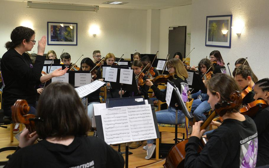 Rebecca Dosch of Supreme Headquarters Allied Powers Europe Middle School in Belgium, claps out the rhythm as the string ensemble rehearse a number at Creative Connections in Oberwesel, Germany, Monday, Nov. 4, 2019.