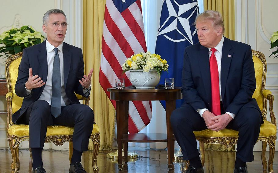 U.S. President Donald Trump listens to NATO Secretary-General Jens Stoltenberg as he answers a question following a meeting at Winfield House in London, Tuesday, Dec. 3, 2019, ahead of the NATO summit marking the alliance's 70th anniversary.