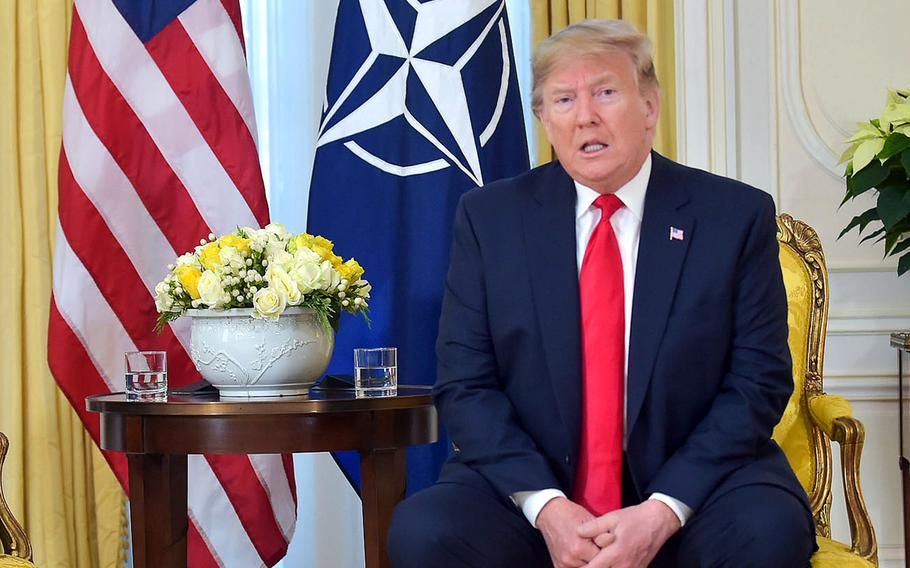 U.S. President Donald Trump anwers a question from the media after he and NATO Secretary-General Jens Stoltenberg delivered opening remarks at Winfield House in London, ahead of the NATO summit in London, Tuesday, Dec. 3, 2019.