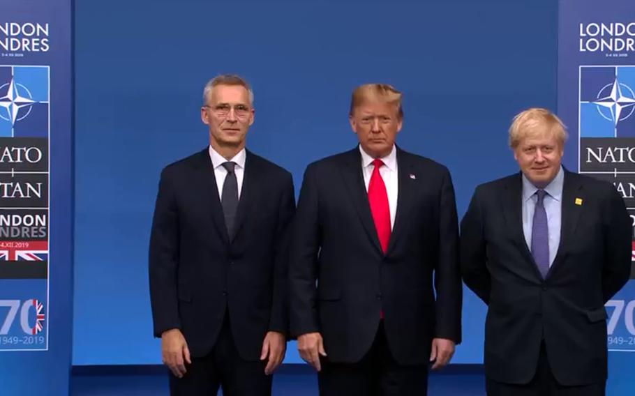 NATO Secretary-General  Jens Stoltenberg, U.S. President Donald Trump and British Prime Minister Boris Johnson at the handshake ceremony before the meeting of NATO leaders on the outskirts of London, Wednesday, Dec. 4, 2019.