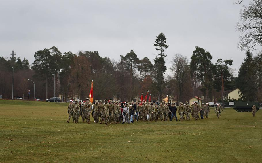 German and American soldiers marched 3 miles at Grafenwoehr Training Area with service members and their children as part of a toy drop, which will deliver hundreds of toys and school supplies to the Haus St. Elisabeth children's home in Windischeschenbach, Germany.