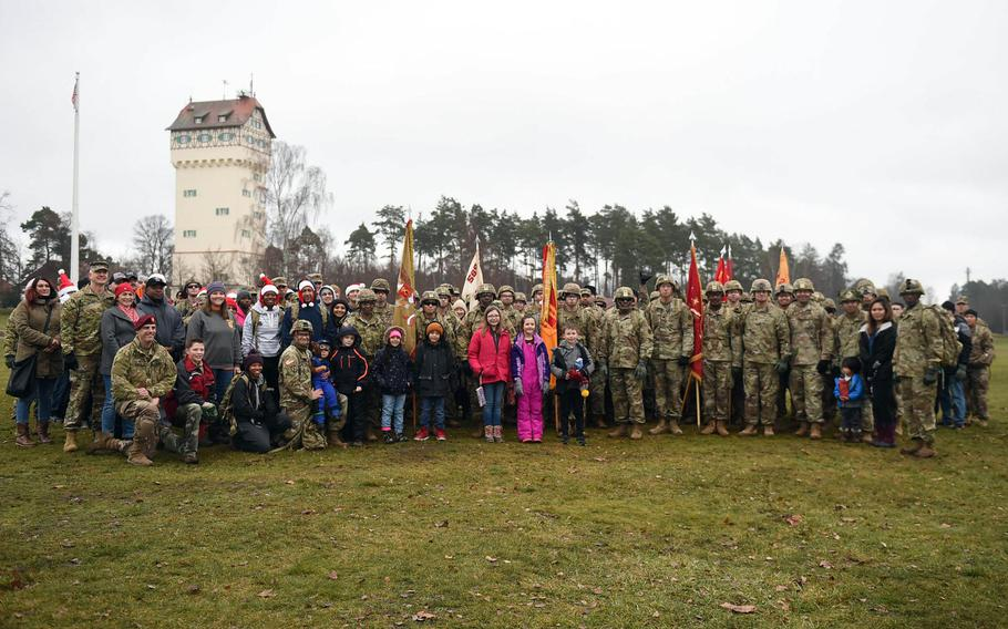 Soldiers pose for a photo at Grafenwoehr, Germany, on Dec. 12, 2019, where a toy drop was organized to collect and distribute some 600 toys and school supplies to children in need.