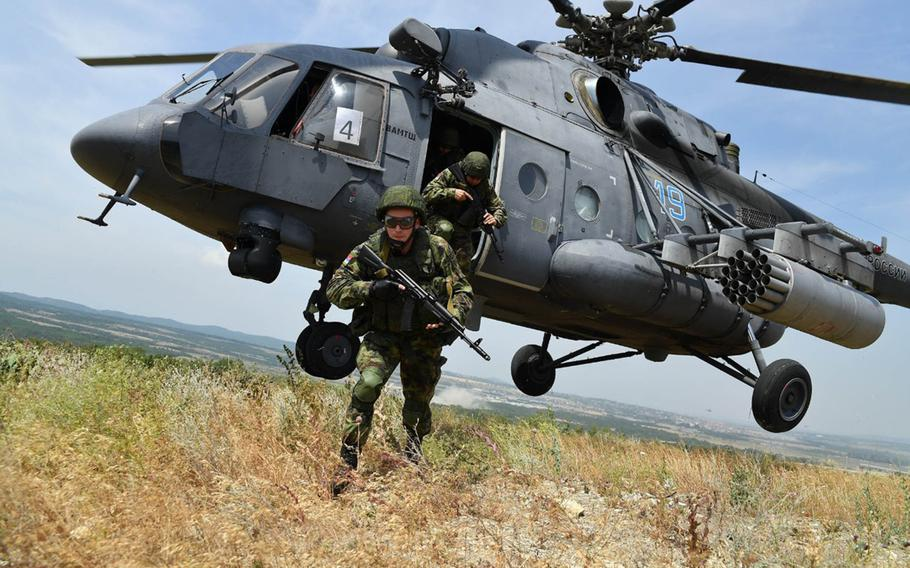 Belarus military members exit an Mi-8 helicopter during a training exercise, in an undated photo. Belarus defense chief Oleg Belokonev said his country is open to participating in joint exercises with NATO.