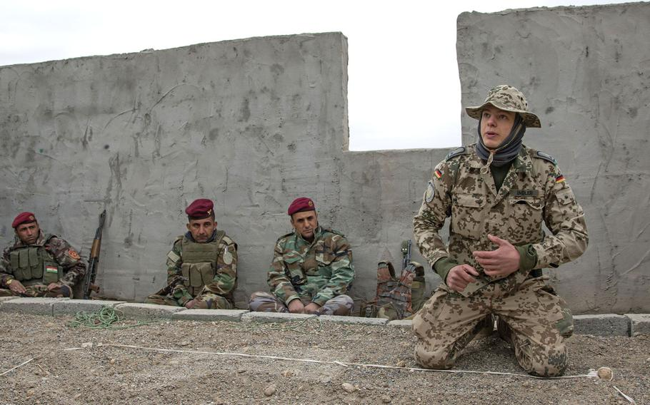 A German army trainer provides counter-improvised explosive device training in Iraq in 2017.  Some allies have begun pulling their forces out of Iraq because of security concerns in the country. Germany will send 30 of its 120 soldiers in Iraq to Jordan and Kuwait.