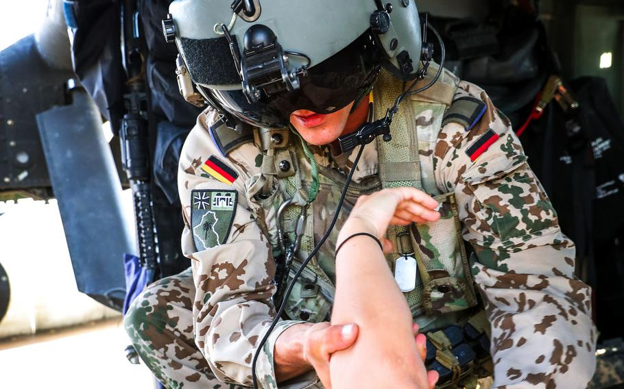 A German soldier examines another soldier during aeromedical training in Iraq in May 2019. Some allies have begun pulling their forces out of Iraq because of security concerns in the country. Germany will send 30 of its 120 soldiers in Iraq to Jordan and Kuwait.