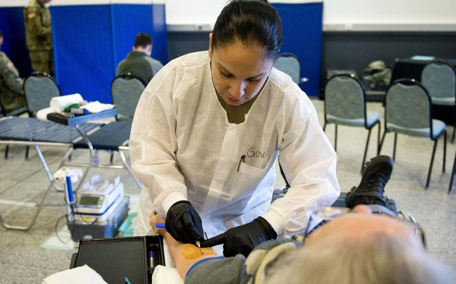 U.S. Army Staff Sgt. Christina Gomez draws blood from a donor at Ramstein Air Base, Germany in 2018. The Armed Services Blood Program Europe put out a call for specific blood types for U.S. service members deployed to Africa, asking for people to donate at a blood drive this week at Landstuhl Regional Medical Center.