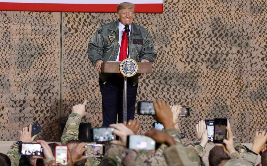 President Donald Trump speaks to service members during a visit to Al Asad Air Base, Iraq, Dec. 26, 2018. Trump proposed expanding NATO to include the Middle East and suggested calling it NATO-ME.