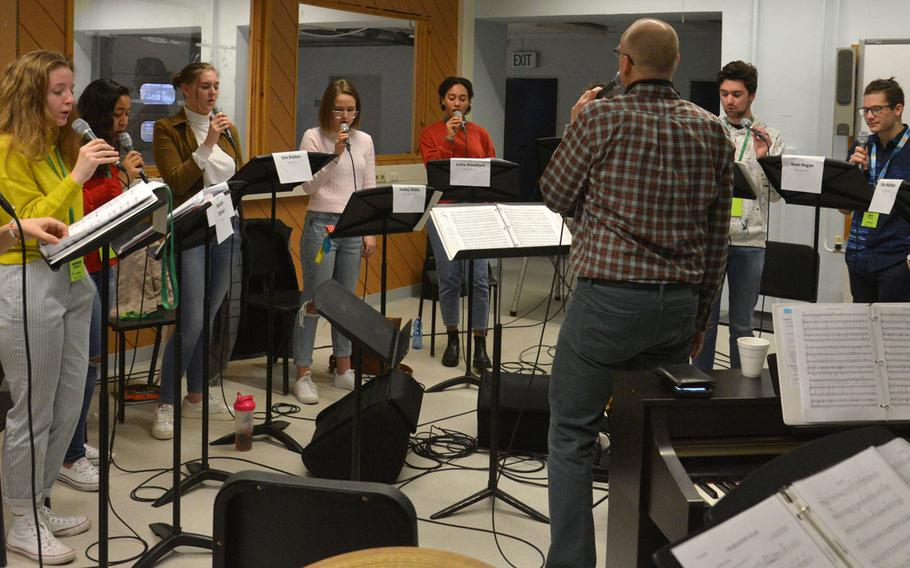 Darmon Meader, the guest clinician and conductor at the 2020 DODEA-Europe Jazz Festival, leads the vocal jazz ensemble through a rehearsal in Kaiserslautern, Germany, Jan. 14, 2020.