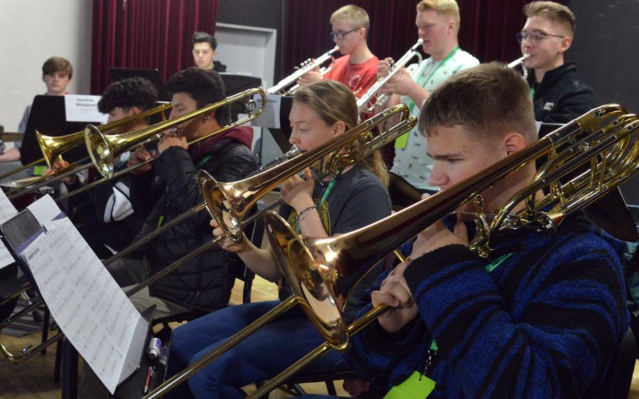 The big band trombone section practices a song at the 2020 DODEA-Europe Jazz Festival in Kaiserslautern, Germany, Jan. 14, 2020.