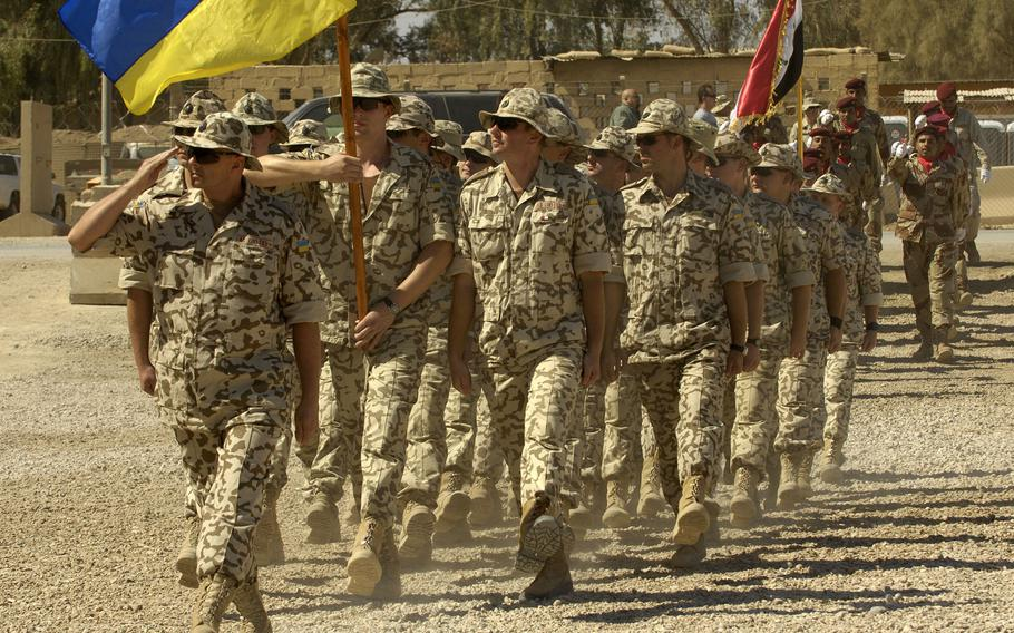 Ukrainian soldiers march past the parade grandstand during a pass and review at Camp Echo, Iraq in 2008. Ukraine plans to send 20 troops to support NATO?s mission in Iraq when the alliance resumes work in the country.
