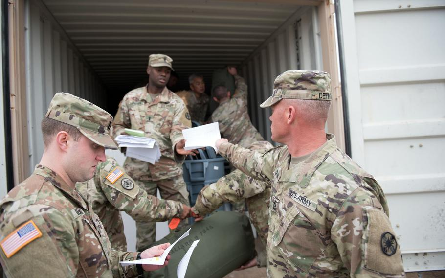 Sgt. Maj. Erick M. Detrich, 13th Expeditionary Sustainment Command, hands in his duffle bag inventory sheet as he loads his bag into a connex at Fort Hood, Texas, Jan. 13, 2020. The loading of tanks and other gear for transport to Europe, due to begin Jan. 23, marks the beginning of Defender-Europe 20, the largest exercise on the Continent for U.S. forces in 25 years.