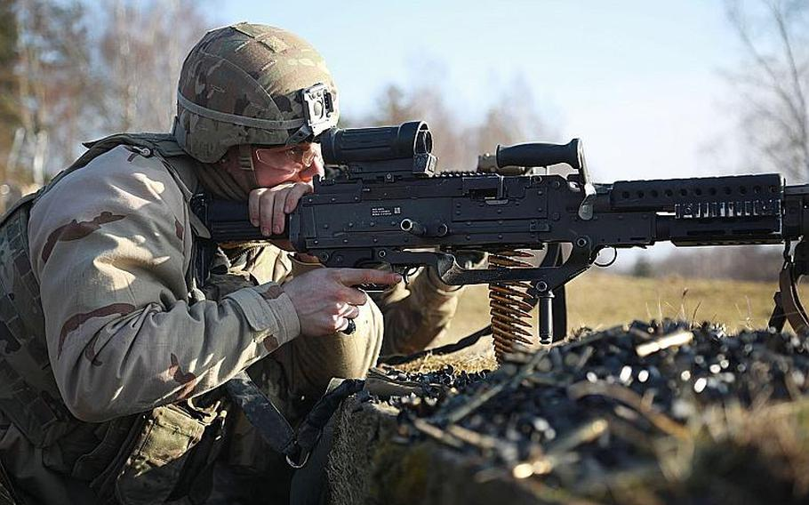 A U.S. 1st Cavalry Division soldier fires a M249 Light Machine Gun during training at Grafenwoehr Training Area, Germany, Jan. 16, 2020. Most NATO members are confident the U.S. will come to their defense if attacked by Russia, but are unwilling to do the same in return according to a Pew Research Center report released Feb. 9, 2020.  Tomarius Roberts/U.S. Army
