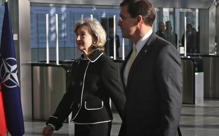 Secretary of Defense Mark Esper walks with U.S. Permanent Representative to NATO Kay Bailey Hutchison before the start of a two-day meeting of defense ministers at the alliance's headquarters in Brussels, Feb 12, 2020.