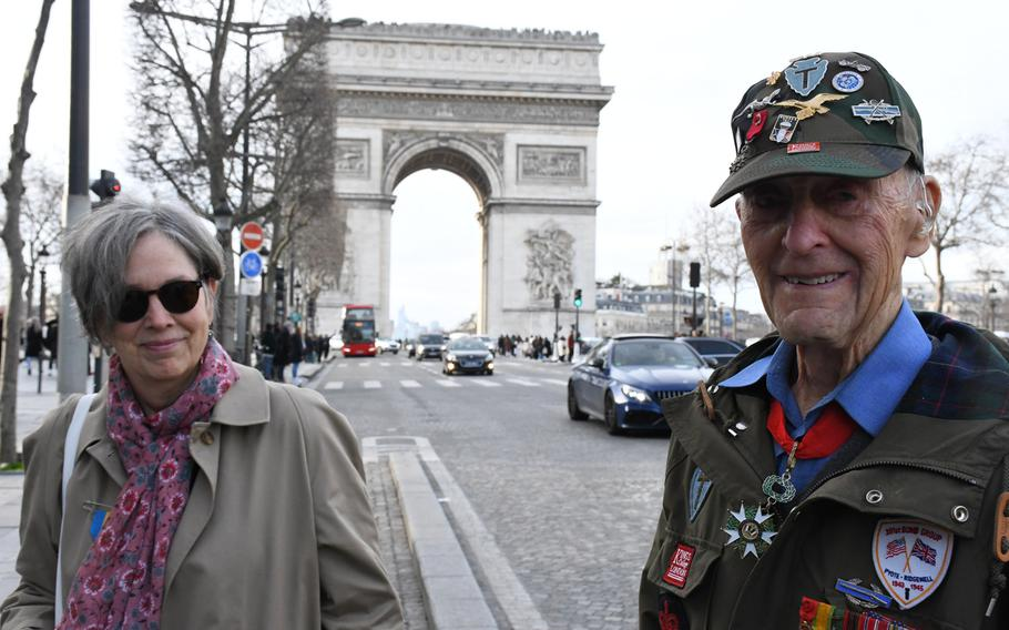 American expatriate Meredith Wheeler and 94-year-old World War II veteran Stephen Weiss are pictured here near Paris's Arc de Triomphe ahead of a ceremony for the rekindling of the eternal flame at the Tomb of the Unknown Soldier under the famous French monument on Friday, Feb. 14, 2020.