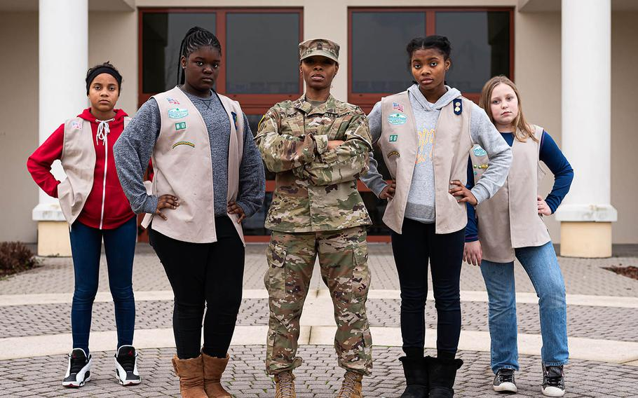 Master Sgt. Vernisa Pope, center, stands with her Vicenza, Italy-based Girl Scouts. From left, the Scouts are Simone Brewington, Alyssa Mallard, Cortnece Pope and Monique Allen.