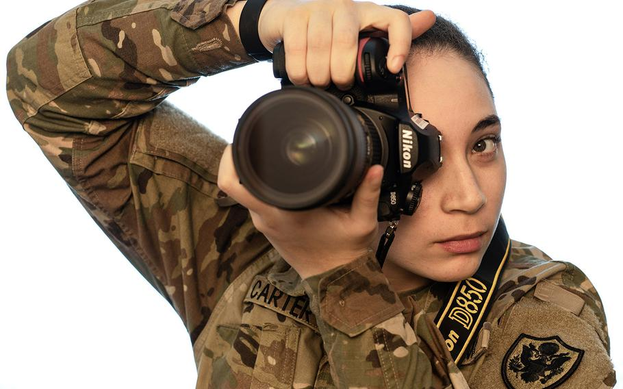 Pfc. Trinity Carter, who is assigned to AFN Vicenza, is part of a photo exhibit highlighting local Americans of color based in Vicenza.