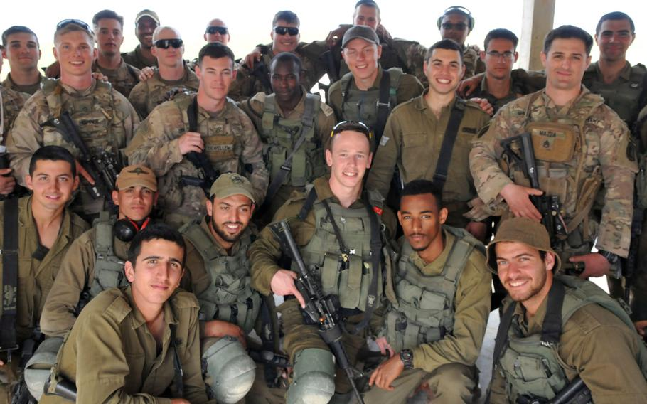 Soldiers with the Vicenza, Italy-based 173rd Airborne Brigade and Israeli Defense Forces soldiers with the 890th Airborne Battalion pose for a photo during training in March 2019 in Israel. Vicenza-based troops who went to Israel last week returned to Italy after an exercise was canceled due to coronavirus-related travel restrictions.