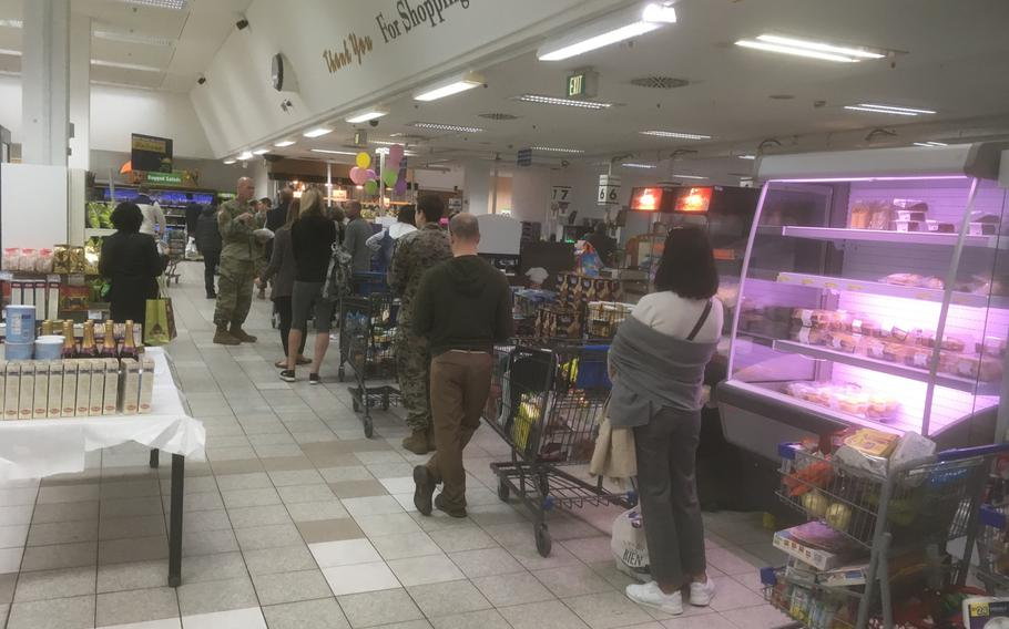 At the Patch Barracks commissary in Stuttgart, shelves are well stocked with supplies Wednesday, March 18, 2020, but some customers appear to be ignoring social distancing rules, which call for people to stand at least one meter away from each other to try to stem the spread of the coronavirus.