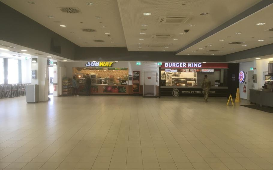 The food court at U.S. European Command's Patch Barracks headquarters in Stuttgart is deserted on Wednesday, March 18, 2020, as the military steps up measures to fight the coronavirus. Tables and chairs have been removed and only take-out orders are available to prevent crowds from gathering.