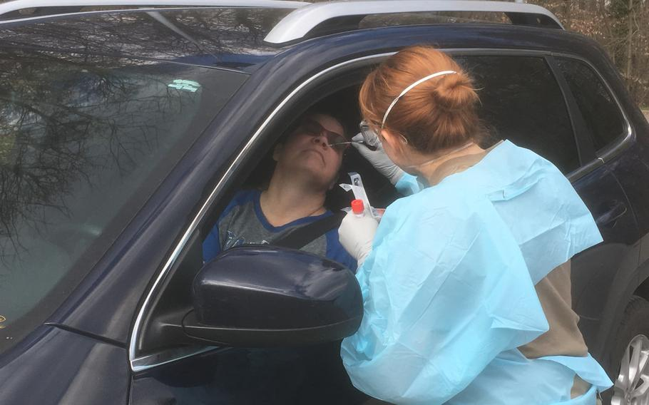 Jakawana Minton, a civilian at the U.S. Army garrison in Stuttgart, gets screened for the coronavirus at a drive-through site next to the health clinic on Patch Barracks. The number of cases within the military community in Stuttgart stood at 15 as of Wednesday, March 18, 2020.