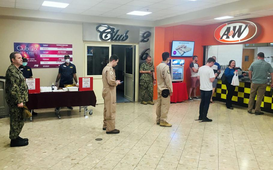 Customers practice social distancing at Naval Support Activity Bahrain, March 25, 2020.