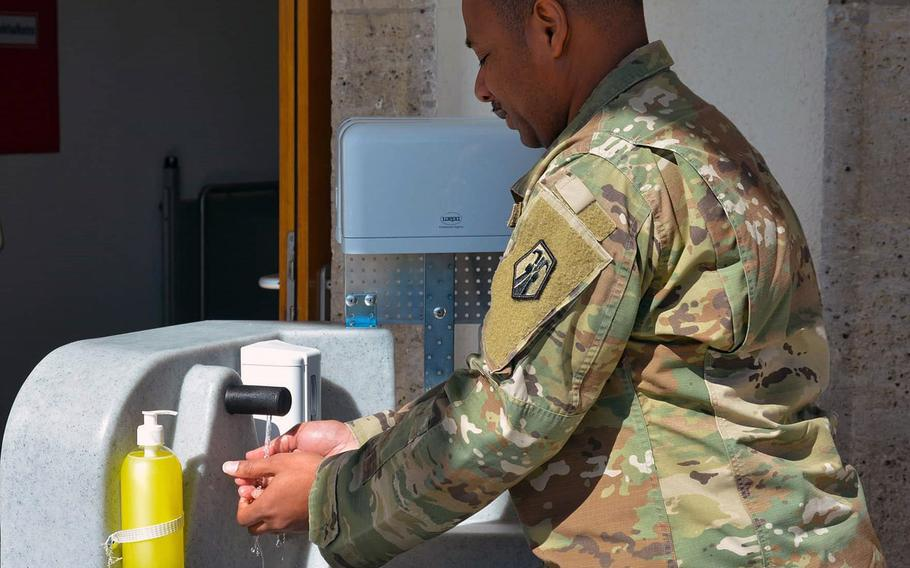 A soldier uses a hand-washing station in Stuttgart in March, one measure taken to stem the spread of the coronavirus at an Army garrison with more than 100 confirmed COVID-19 cases.