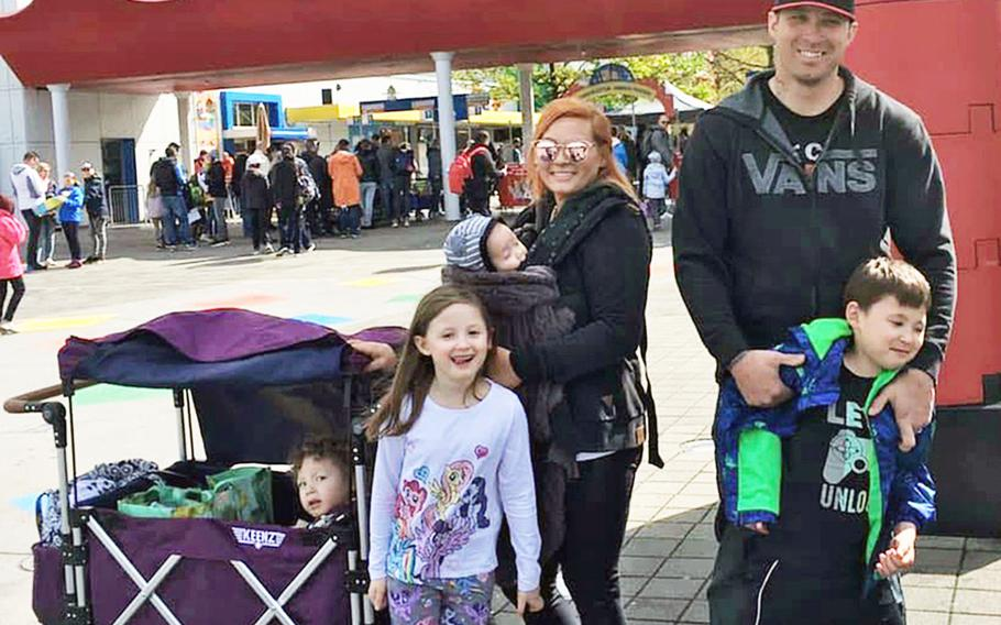 Brittany Frias, center, with her husband, Staff Sgt. Chris Frias, right, and their children at Legoland in Munich, Germany, May 2019, for their oldest son's birthday. Brittany Frias is managing the household, a task made more challenging by coronavirus restrictions, while her husband remains on an extended deployment.