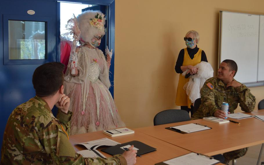 Desse, a physical distancing fairy, ensures Capt. Bryan Westervelt and 1st Sgt. Carmelo Vasquez, both from 12th Combat Aviation Brigade, keep appropriate distancing during a commander and senior leader family advocacy program briefing on Katterbach Kaserne, Germany, April 16, 2020.