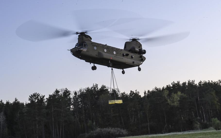 A pilot with the 12th Combat Aviation Brigade lifts a sling load training block during a pilot progression training exercise on Ansbach, Germany, April 20, 2020. The training went ahead, with modifications, in spite of the coronavirus pandemic.