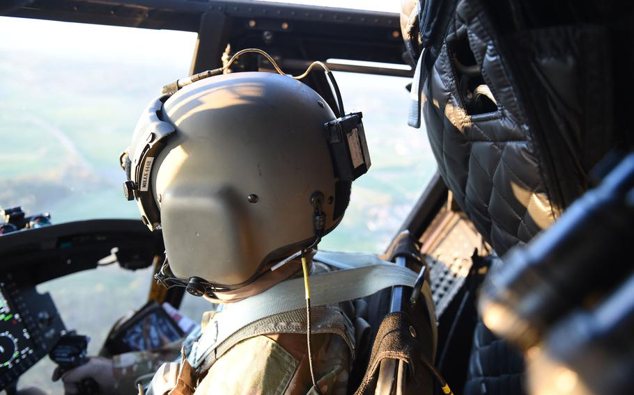 First Lt. Timothy Mills, a pilot with the 12th Combat Aviation Brigade, flies a CH-47 Chinook helicopter during a pilot progression training exercise on Ansbach, Germany, April 20, 2020. The training went ahead, with modifications, in spite of the coronavirus pandemic.
