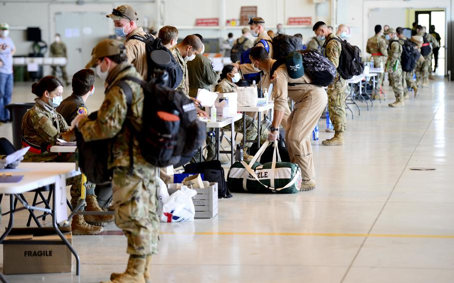 Airmen from across the 31st Fighter Wing, including the 555th Fighter Squadron, participate in coronavirus screenings as they return from deployment, at Aviano Air Base, Italy, April 18, 2020.