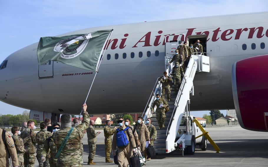 Members of the 555th Fighter Squadron and several other  31st Fighter Wing units disembark a plane at Aviano Air Base, Italy, April 18, 2020. The Triple Nickel is the first full unit from any service to be reintegrated from deployment since the Defense Department implemented coronavirus travel restrictions.