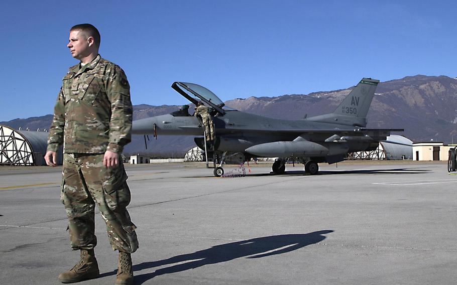 Senior Airman Eric Frank, of the 31st Maintenance Squadron, stands in front of an F-16 Viper at Aviano Air Base, Italy, Feb. 21, 2020. The squadron fabricated steel pins allowing personnel to cut maintenance procedures from 72 hours to just six hours.