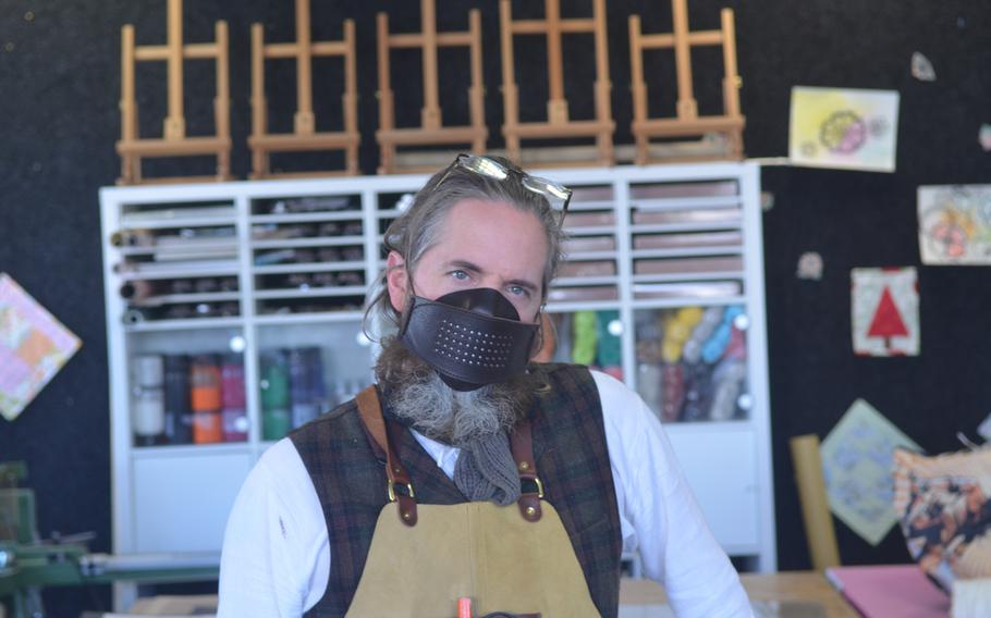 Erik Kraemer, manager at Wiesbaden Arts and Craft Center, Germany, takes a break from making face masks for the local military community on April 17, 2020.