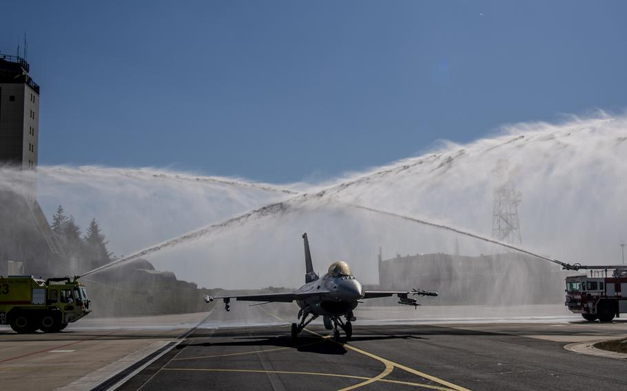 An F-16 Fighting Falcon assigned to the 52nd Fighter Wing at Spangdahlem Air Base, Germany, is given a water salute on Thursday, April 23, 2020, after completing 10,000 flight hours. The F-16 was the first in Europe, and only the second in the U.S. Air Force's inventory, to cross the 10,000 flight-hour mark.