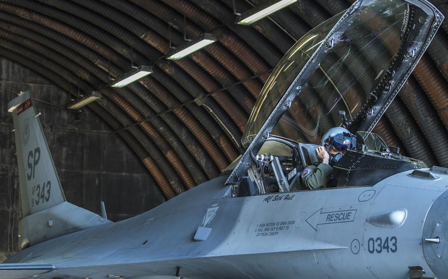 U.S. Air Force Col. Jason Hokaj, 52nd Fighter Wing vice commander, prepares to fly in aircraft No. 343, a F-16 Fighting Falcon, at Spangdahlem Air Base, Germany, on Thursday, April 23, 2020.