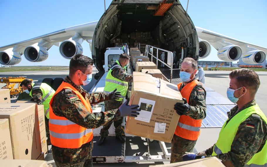 The Antonov-225, the world's largest capacity cargo plane,  is unloaded after arriving at Leipzig/Halle Airport in Germany, April 27, 2020, from China, bringing medical supplies as part of efforts to help curb the spread of the coronavirus.