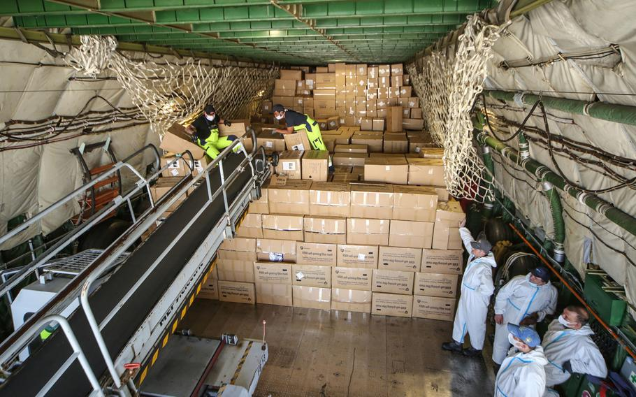 The Antonov-225 cargo plane is unloaded after arriving at Leipzig/Halle Airport in Germany, April 27, 2020, from China, bringing 10 million protective face masks as part of efforts to help curb the spread of the coronavirus.