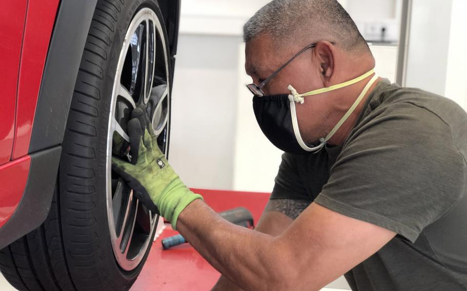 A Family Morale, Welfare and Recreation auto skills worker on Panzer Kaserne, Stuttgart, Germany, changes a tire, April 21, 2020. A two-week stretch with no new coronavirus cases ended April 29 for the garrison, its commander said.