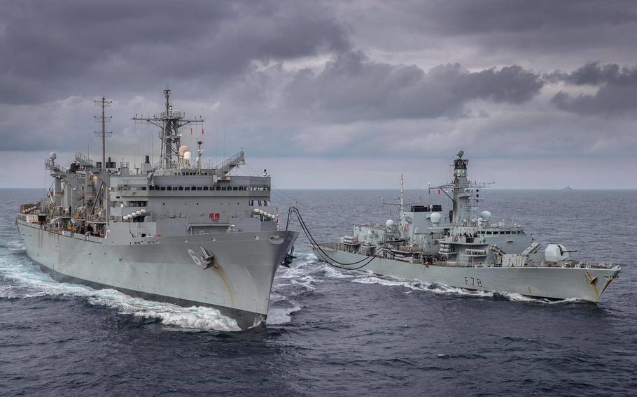 The Royal Navy's HMS Kent, right, takes part in a replenishment-at-sea with fast combat support ship USNS Supply during an  exercise with the U.S. Navy in the Arctic Circle, May 3, 2020.