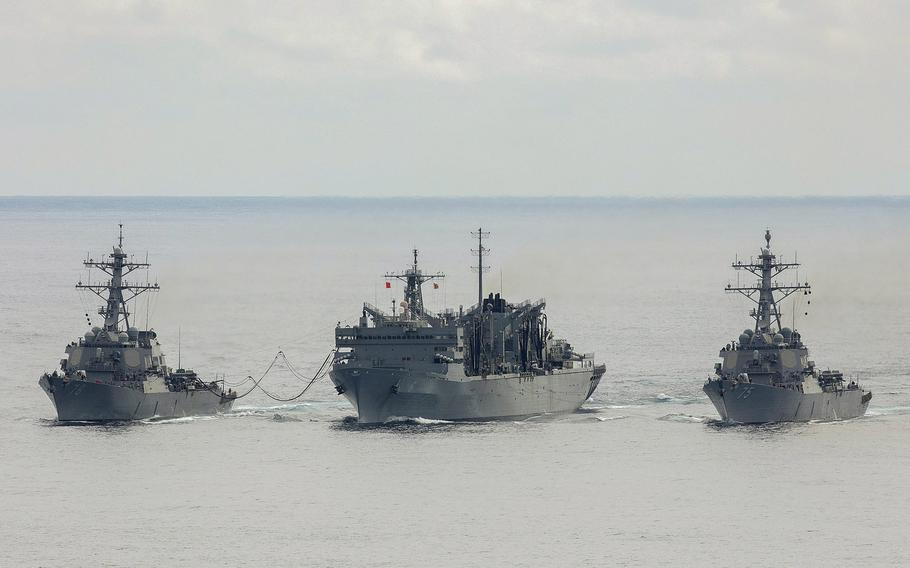The U.S. Navy destroyers USS Porter, left, and USS Donald Cook, right, replenish from the fast combat support ship USNS Supply while operating with the Royal Navy frigate HMS Kent, not pictured, above the Arctic Circle during a bilateral anti-submarine exercise in the North Sea, April 28, 2020.