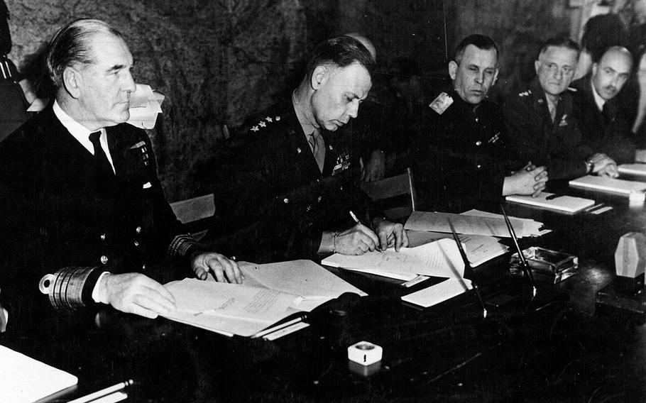 U.S. Lt. Gen. Walter Bedell Smith, chief of staff to General of the Army Dwight D. Eisenhower, Supreme Commander-in-Chief Allied Expeditionary Force, signs on behalf of the Allied High Command the document of unconditional surrender of Germany. The unconditional surrender of Germany was signed at 2:41 a.m. May 7, 1945, in Reims, France.