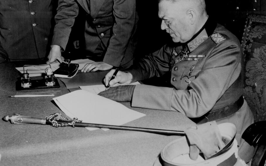 Field Marshal Wilhelm Keitel signing the German surrender in Berlin, on May 9, 1945. The event took place two days after a document was signed by German officials in Reims, France, and announced the following day, May 8.